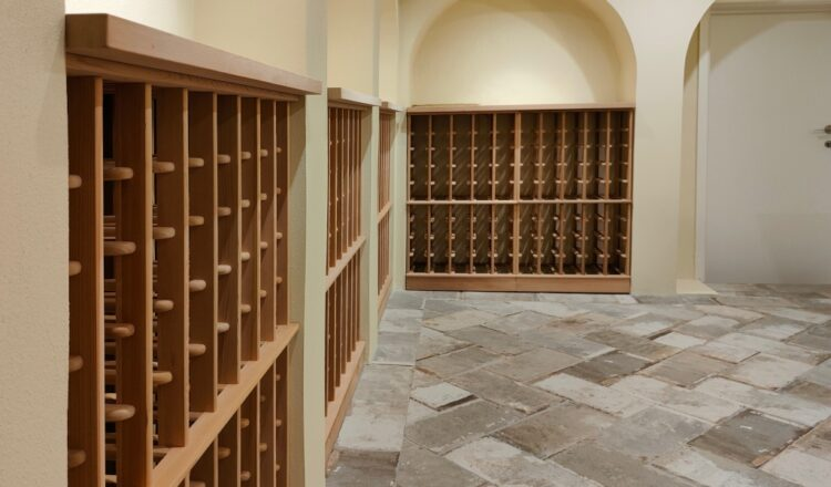 Curved Cedar Wine Cellar Racking Wall wine bays with Cedar Benches and curved tops.